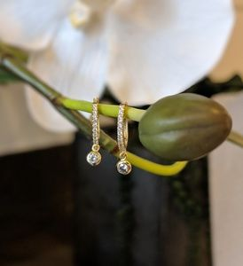 Jewelry - Gold earrings with a hanging diamond